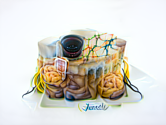 A pile of brains and viscera is topped by a road map and a glistening camera eye. Wirelike tendrils trail from either side of the cake.