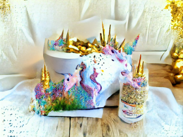 A cake sits on a wooden floor next to a glass full of unfrosted cake. Rainbow frosting gardens and gleaming golden horns are scatterd across the cake. There is a unicorn face emerging from the side of the cake and beginning to eat from the glass.