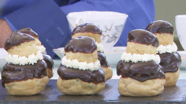 Each pastry is made of two round choux buns, dipped in chocolate and stacked together with cream.