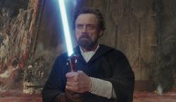 luke holding a lightsaber on crait