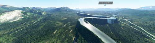 A panoramic view of a wide mountain landscape in Alaska's Denali National Park. A river winds through the valley, on its own steep-sided platform elevated thousands of feet high.