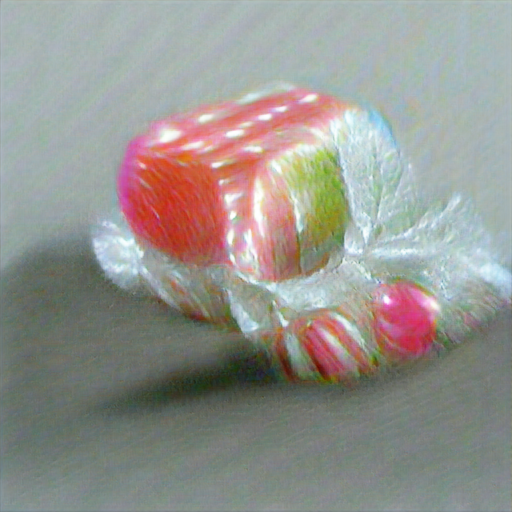 Some kind of pink and green striped hard candy nestled in cellophane