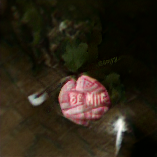 """A dark background with a vaguely circular candy. It looks very lumpy with embossed lettering. If you knew it was supposed to say """"Be Mine"""" you could recognize it, but none of the letters are quite right."""