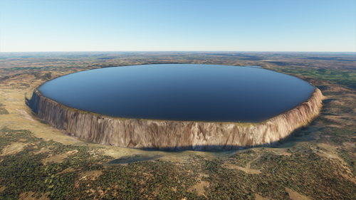 An incredibly steep-sided mesa is topped with a mirrorlike lake stretching out to its edge. The mesa walls are probably thousands of feet tall.
