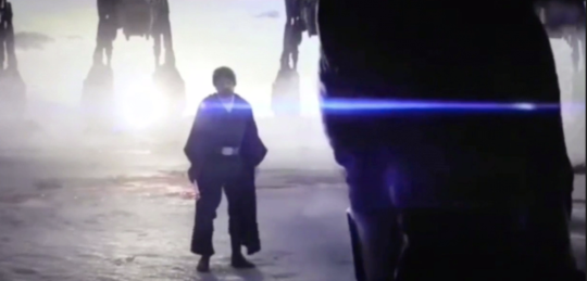 luke standing facing kylo, with at-ats in the backgrounnd